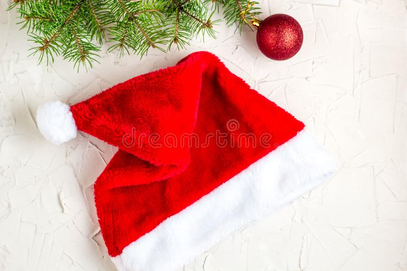 Santa hat and fir tree branches. Christmas composition. Top view, flat lay stock image