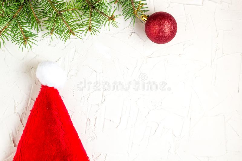 Santa hat and fir tree branches. Christmas composition. Top view, flat lay stock photos
