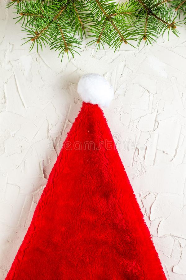Santa hat and fir tree branches. Christmas composition. Top view, flat lay royalty free stock images