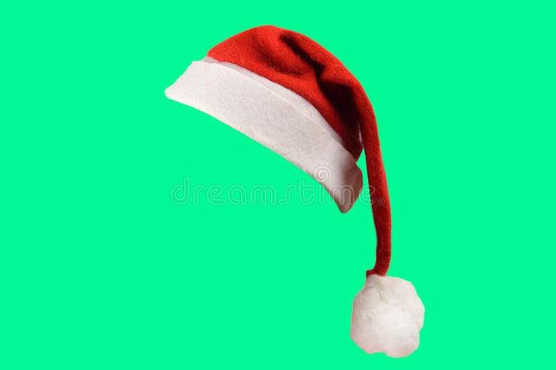 Santa hat isolated. Christmas santa hat isolated on green background. designed to easily put on persons head royalty free stock images