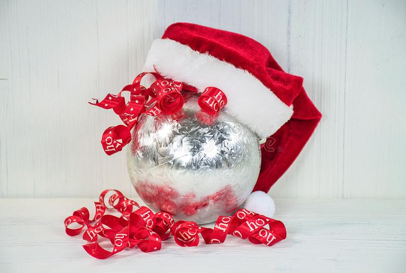 Santa hat on silver ornament royalty free stock images
