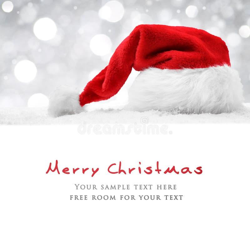 Santa hat on snow stock images