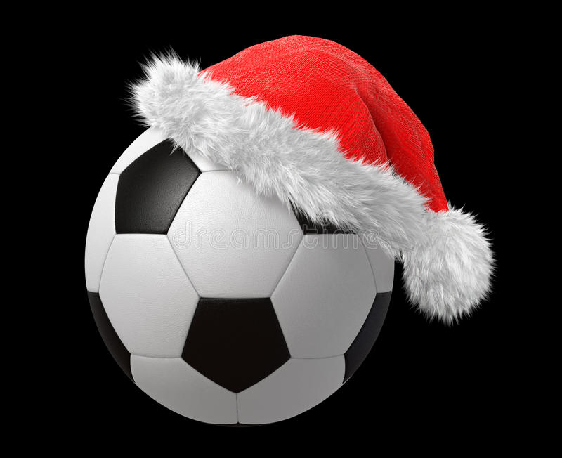 Santa hat on a soccer ball stock photography