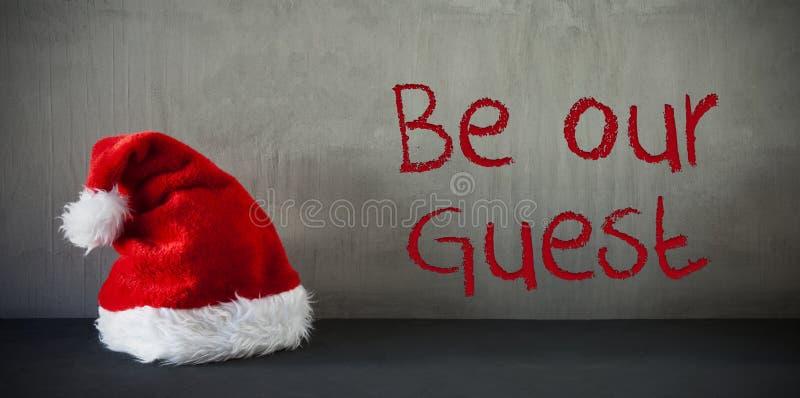 Santa Hat, texto seja nosso convidado imagens de stock royalty free