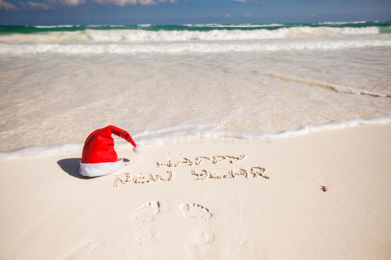 Santa Hat On White Sandy Beach And Happy New Year Stock ...