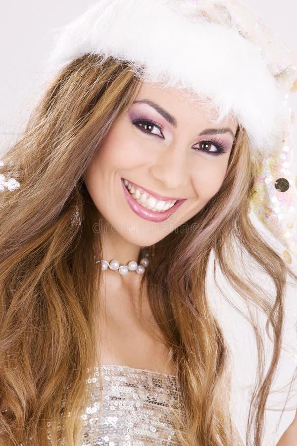 Santa helper girl over grey royalty free stock images