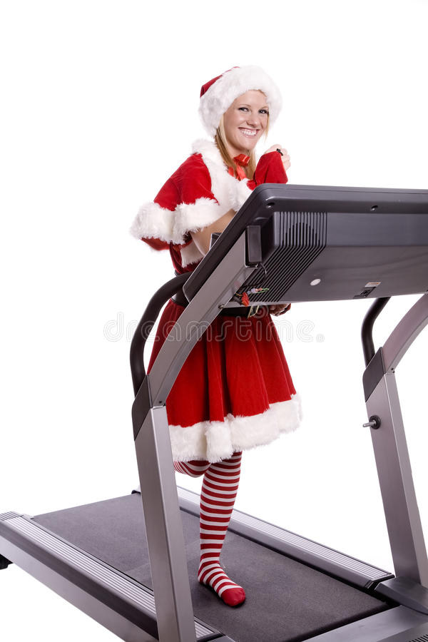 Download Santa Helper On Treadmill Stock Photos - Image: 11939963