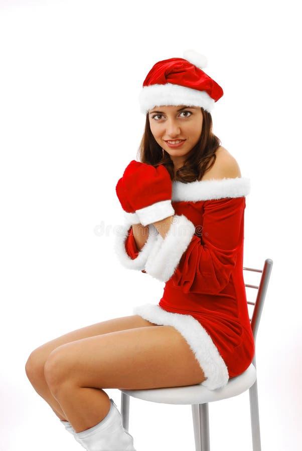 Santa heureuse dans la robe et des mitaines courtes photos stock