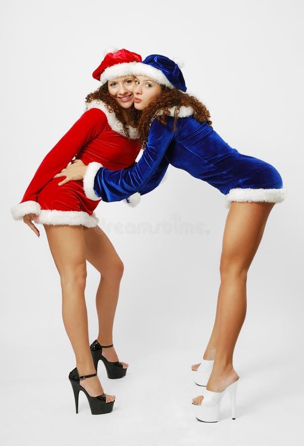 Santa heureuses saluant un un autre. images stock