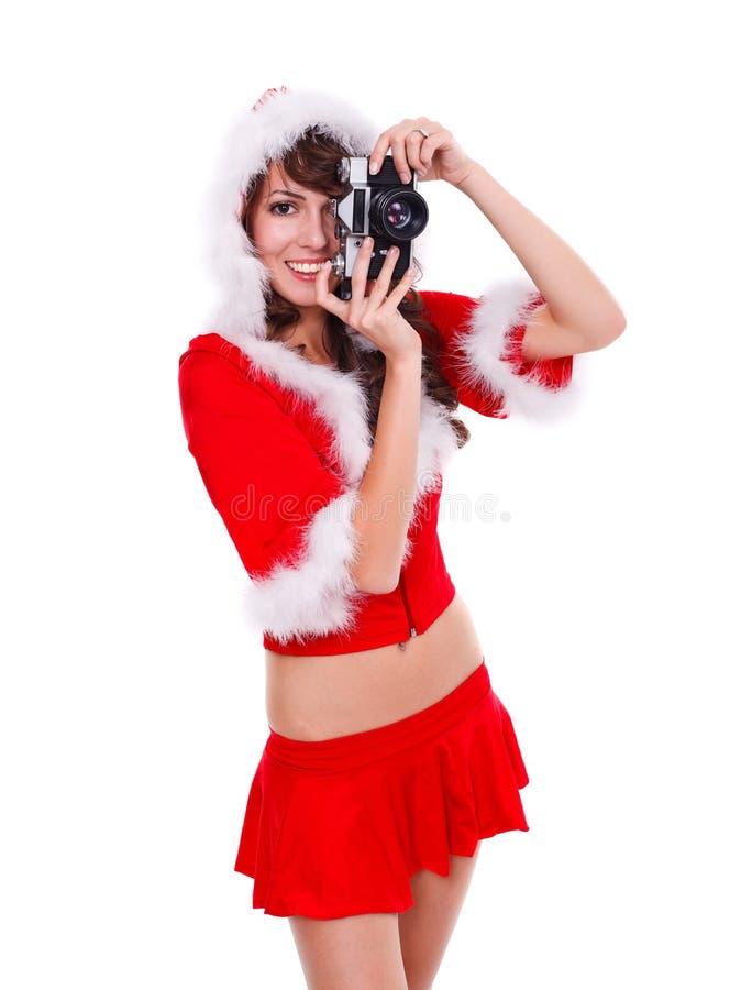 Santa hjälpreda med den retro kameran arkivfoto