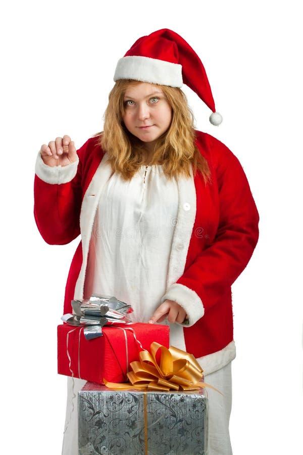 Santa hjälpreda med gåvor royaltyfria foton