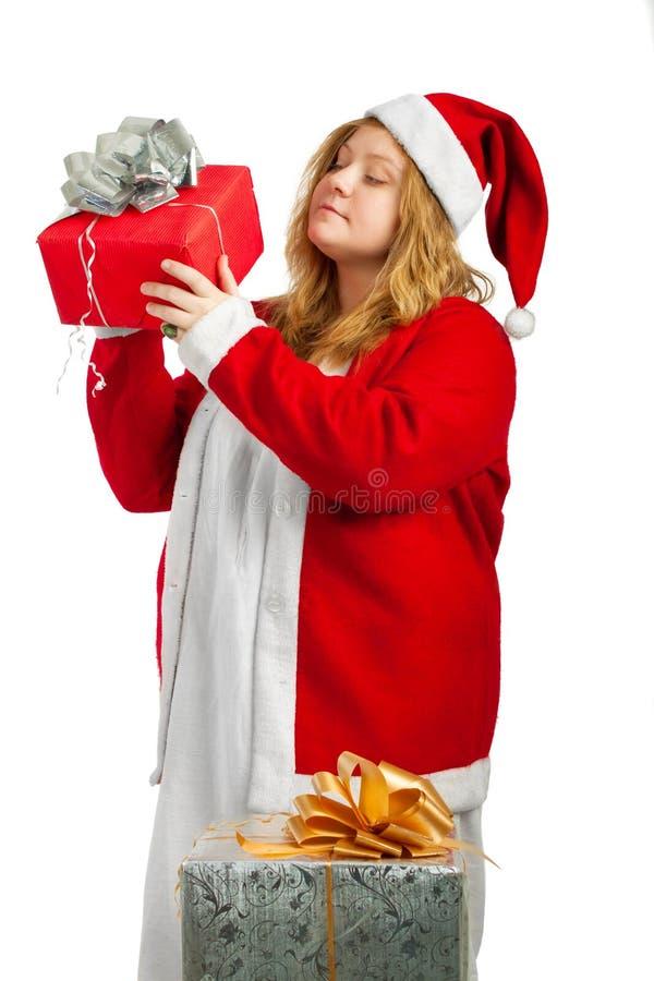 Santa hjälpreda med gåvor fotografering för bildbyråer