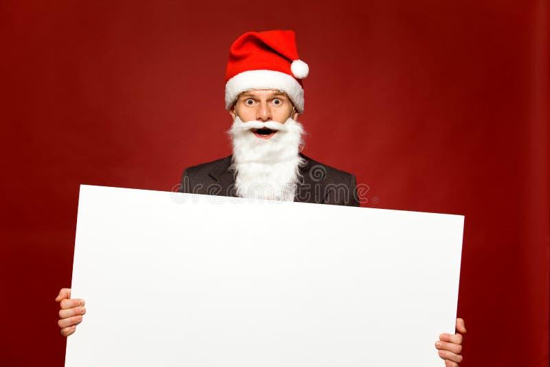Santa holding blank poster royalty free stock photo