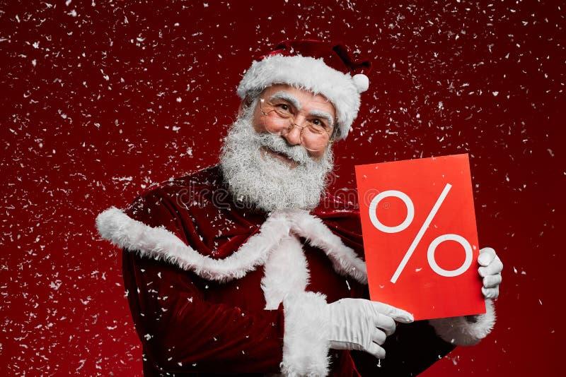 Santa Holding Sale Sign in Snow stock photos