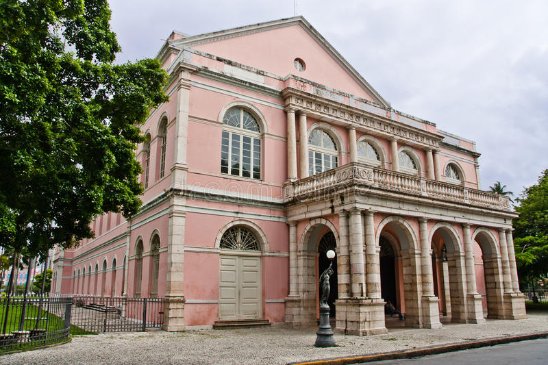 Santa Isabel Theatre Recife. The facade of the pink Santa Isabel Theatre in downtown Recife, Pernambuco with its classical bulb street lamp statues and arches stock images