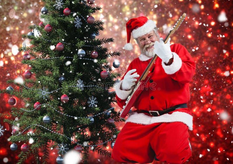 Santa jouant la guitare électrique photographie stock libre de droits