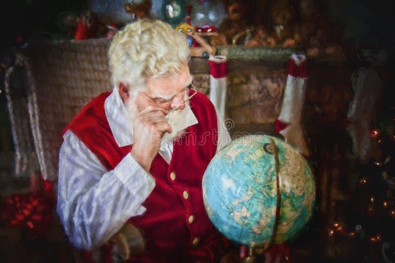 Santa Klaus studying the globe royalty free stock photography