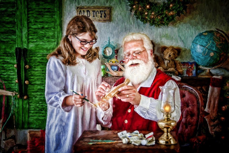 Santa Klaus with a young girl. Man with white beard, red waistcoat and gold rimmed glasses, portraying Santa Klaus, showing a toy (painter's palette) to a stock photo