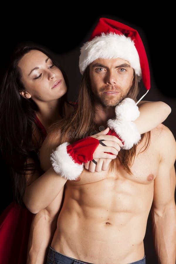 Santa la couplent derrière qu'il sourit images libres de droits