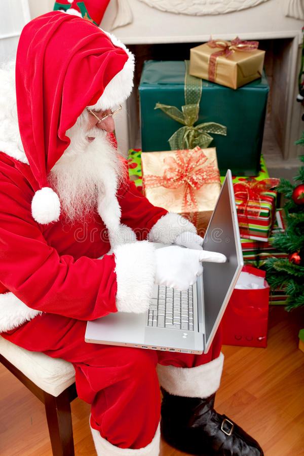 Download Santa with a laptop stock image. Image of holiday, pointing - 13296333