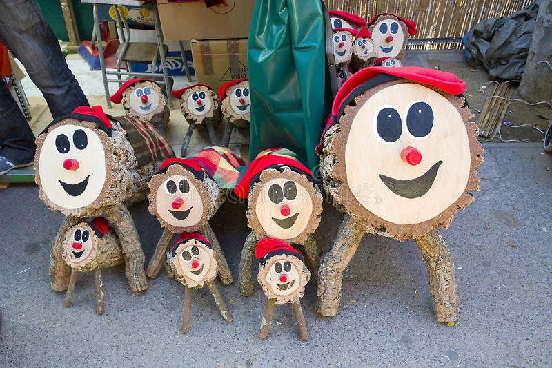 Santa Llucia Christmas Fair, Barcelona. Caga tio, a character in Catalan mythology relating to a Christmas tradition in Catalonia seen painted on logs at Santa stock photos