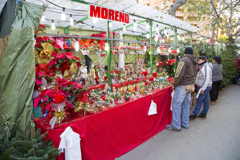 Santa Llucia Christmas Fair, Barcelona. Santa Llucia Fair starts in Barcelona, Spain, on December 1, 2013. People visit the shops to buy Christmas decoration, as stock photo
