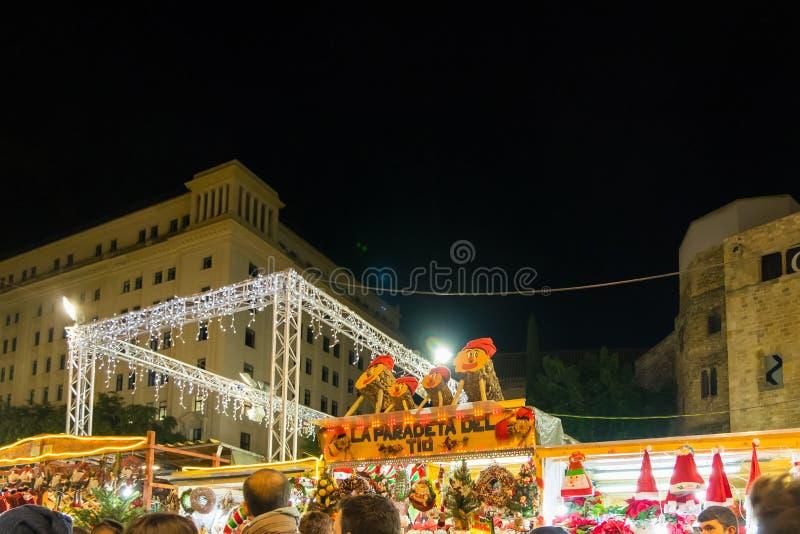 Santa Llucia christmas market at night in Barcelona, Catalonia, Spain stock images