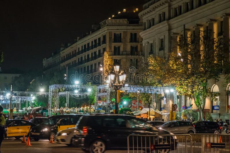 Santa Llucia christmas market at night in Barcelona, Catalonia, Spain stock images