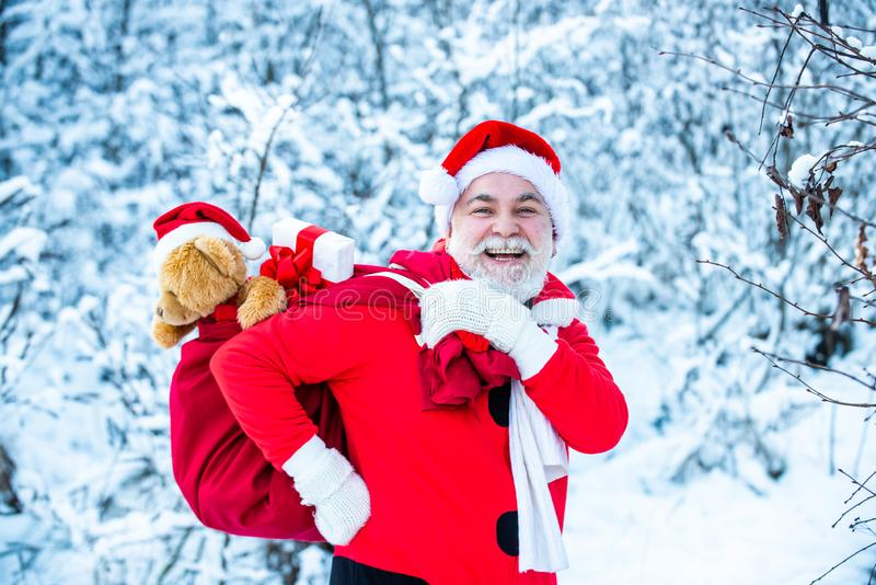 Santa magical fog walking along the field. Merry Christmas. Santa Claus comes with gifts from the outside. Santa Claus stock photography