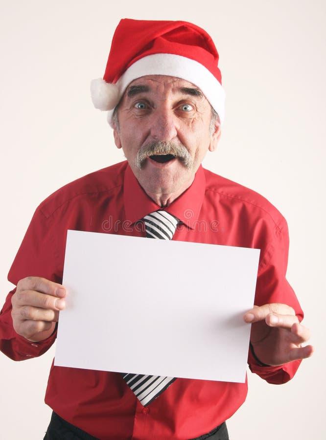 Santa man with blank sign stock image