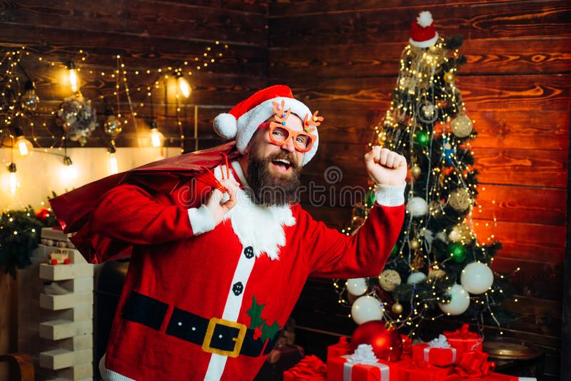 Santa man posing on vintage wooden background. Christmas people celebration New Year. Santa Claus wishes Merry Christmas royalty free stock images