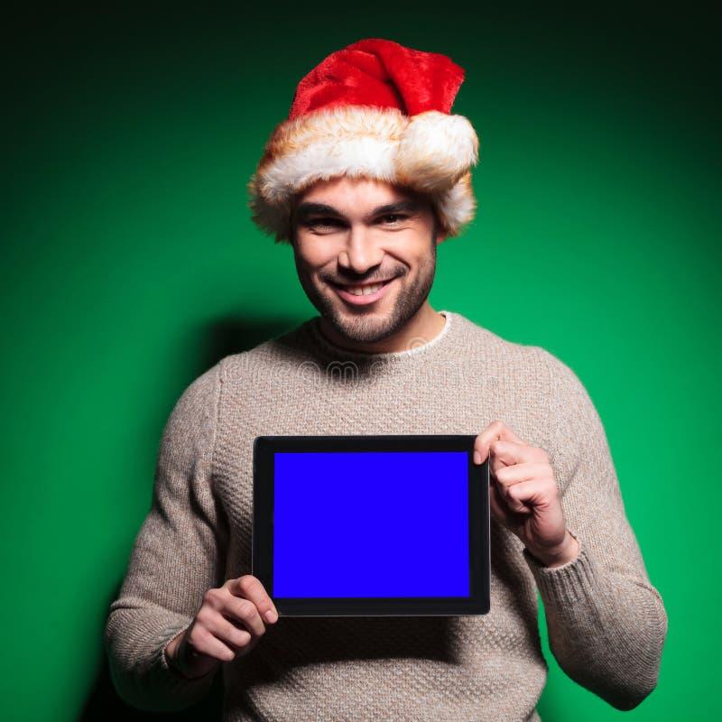 Santa man showing blank screen of tablet pad royalty free stock image