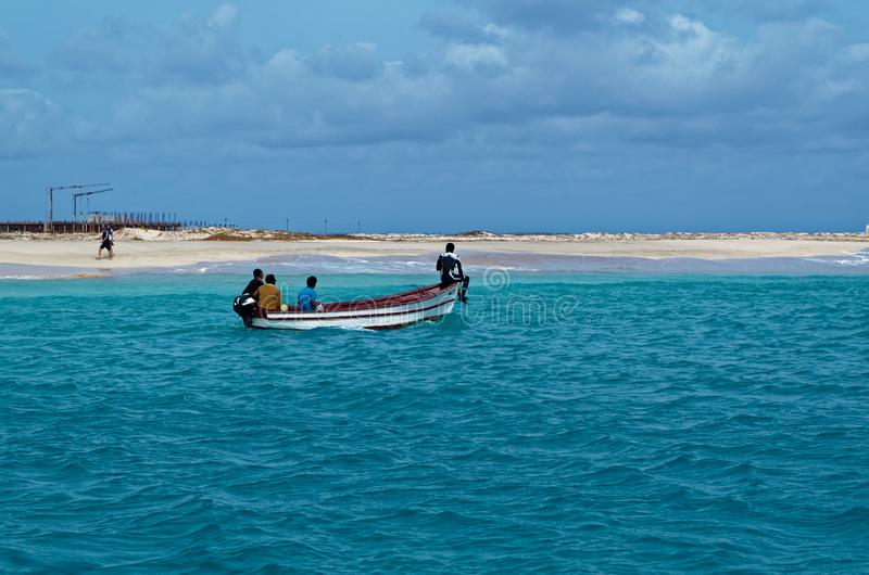 4 fishermen boating along a coastline. Island Sal, Cape Verde stock photos