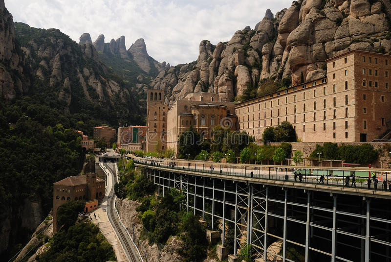 Santa Maria de Montserrat. Is a Benedictine abbey located in the Montserrat mountain, in Monistrol de Montserrat, in Catalonia, Spain. Montserrat, whose name stock photography