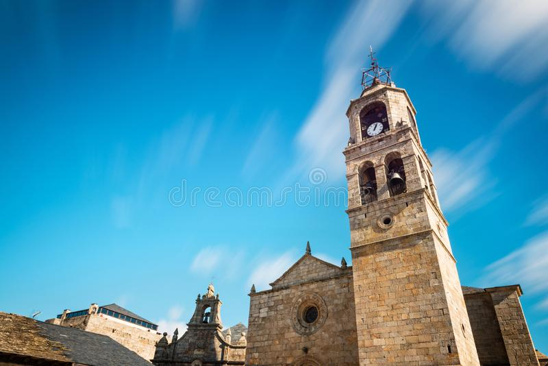 Santa Maria del Azogue church in Puebla de Sanabria. Low-angle view of the main tower of Santa Maria del Azogue roman church in Puebla de Sanabria against a royalty free stock images