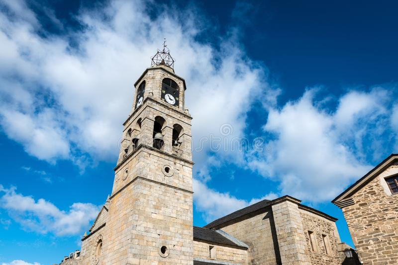 Santa Maria del Azogue church in Puebla de Sanabria. Low-angle view of the main tower of Santa Maria del Azogue roman church in Puebla de Sanabria against a stock photography
