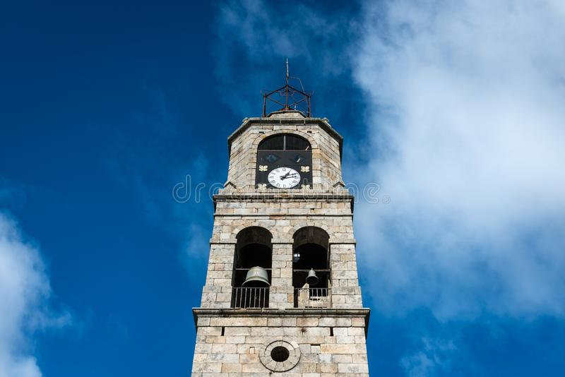 Santa Maria del Azogue church in Puebla de Sanabria. Low-angle view of the main tower of Santa Maria del Azogue roman church in Puebla de Sanabria against a royalty free stock photo