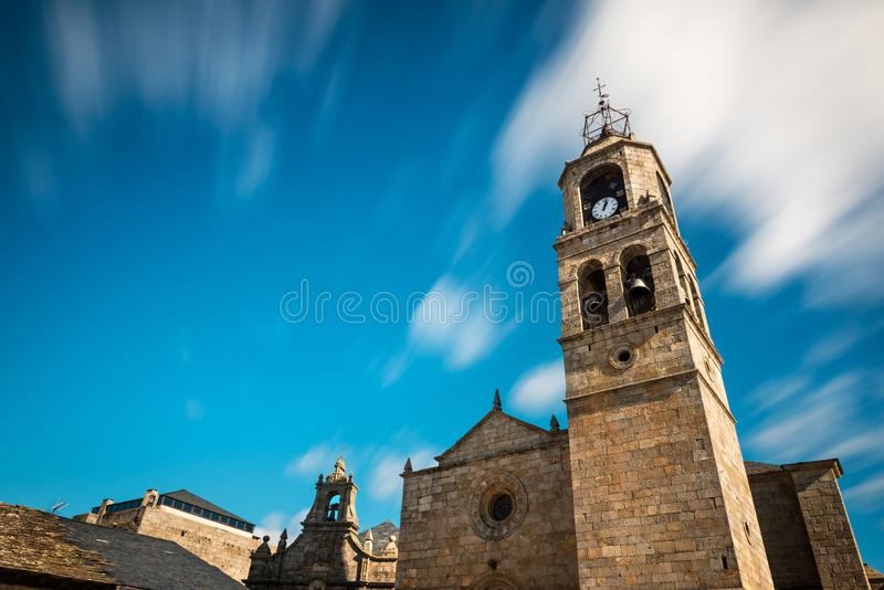 Santa Maria del Azogue church in Puebla de Sanabria. Low-angle view of the main tower of Santa Maria del Azogue roman church in Puebla de Sanabria against a stock photos