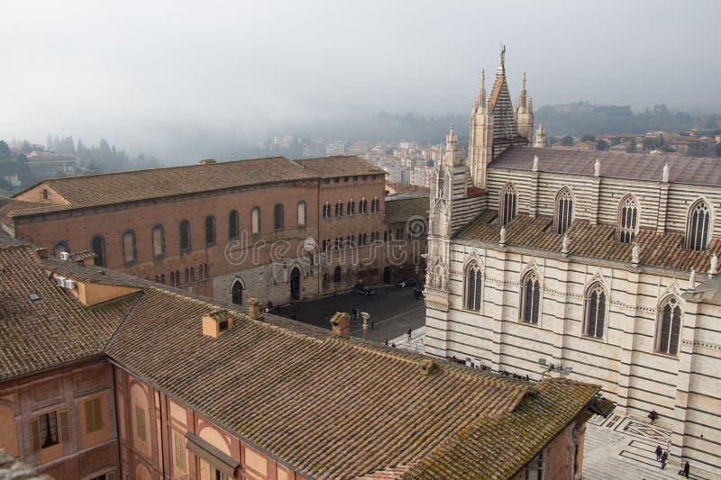 Santa Maria della Scala and Metropolitan Cathedral of Santa Maria Assunta on Piazza del Duomo di Siena. View from facciatone Tusca stock photo