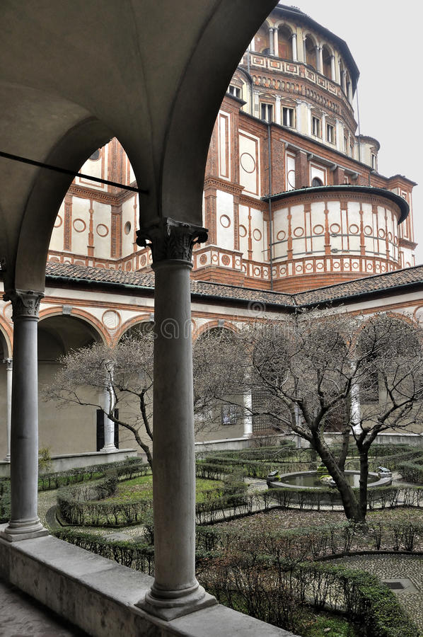 Santa maria delle grazie side and cloister, milan. Milan (Italy), 2011/02/27: foreshortening of ancient cloister of the famous church in city center, shot in stock photos