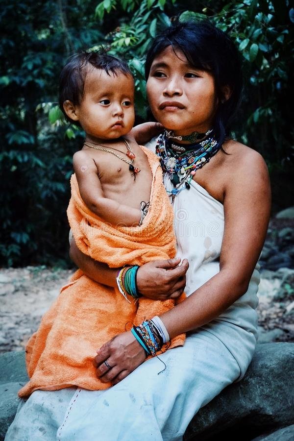 Kogi tribal member mother with his new born son. Santa Marta, Magdalena / Colombia - MARCH 10 2016 : kogi tribal member mother with his new born son stock photography