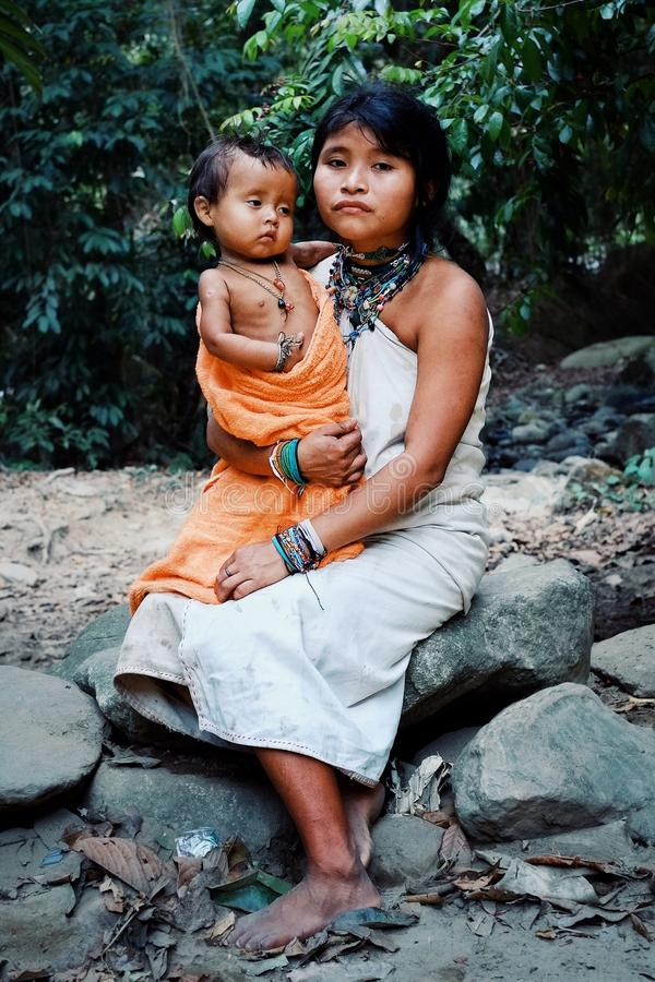 Kogi tribal member mother with his new born son. Santa Marta, Magdalena / Colombia - MARCH 10 2016 : kogi tribal member mother with his new born son royalty free stock photography