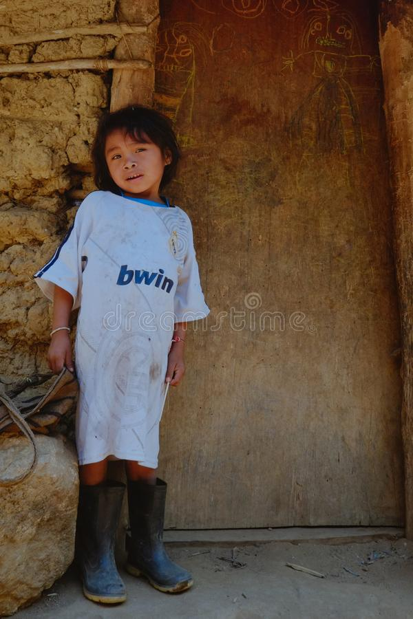 Tribal kogi kid in front of their family home. Santa Marta, Magdalena / Colombia - MARCH 10 2016 : tribal kogi kid in front of their family home stock image