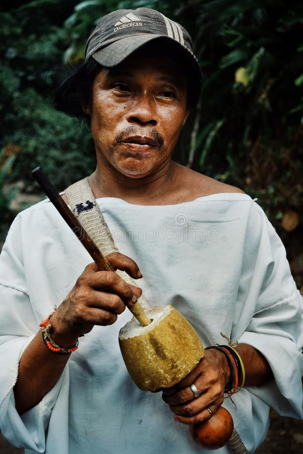 Tribal kogi man with his poporo the ancient device helping the tairona nation. Santa Marta, Magdalena / Colombia - MARCH 10 2016 : tribal kogi man with his royalty free stock photos