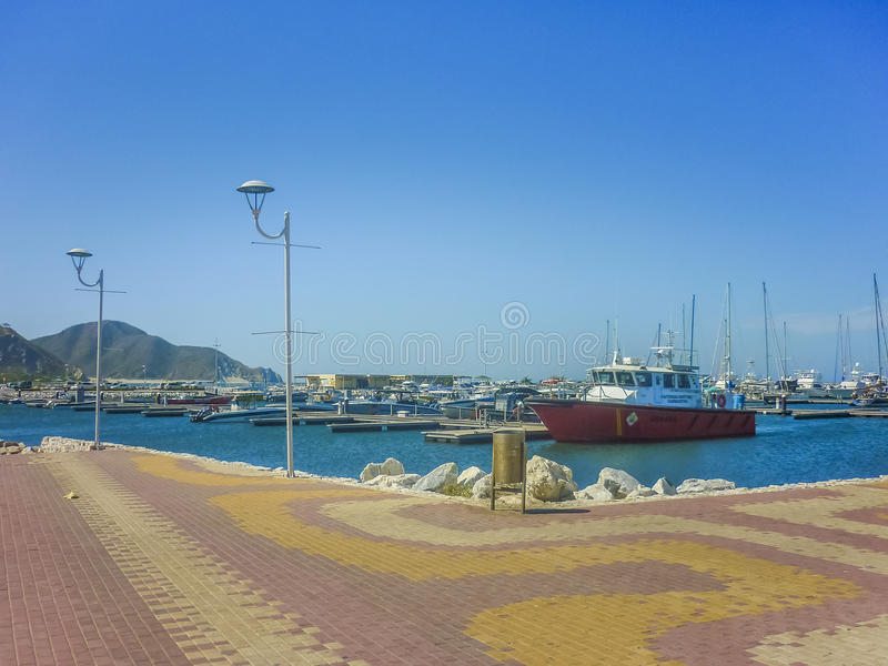 Santa Marta Port. SANTA MARTA, COLOMBIA, JANUARY - 2015 - Perspective view of port with boats and little ships at the port of Santa Marta, one of the most royalty free stock images