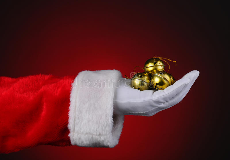 Santa med handfullsleighen Klockor arkivbilder