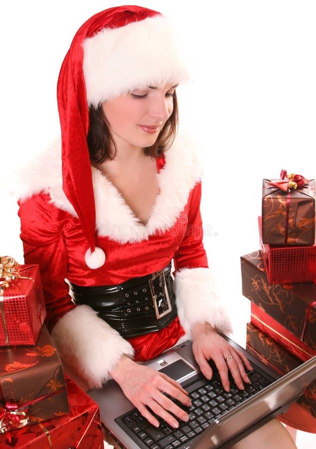 Santa-menina com portátil imagens de stock royalty free