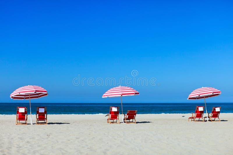 Santa Monica beach. Three sun umbrellas at Santa Monica beach stock photo