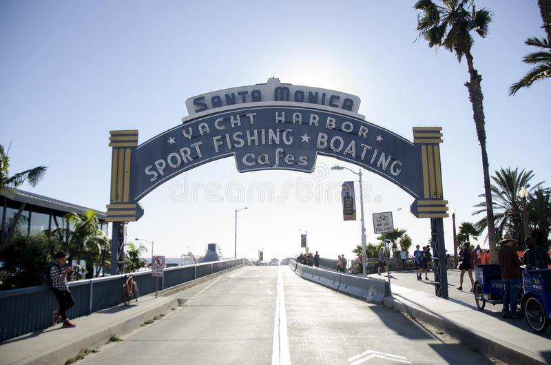 Santa Monica beach pier sign. This is the sign to the santa monica beach pier and sport and fishing cafes royalty free stock photography