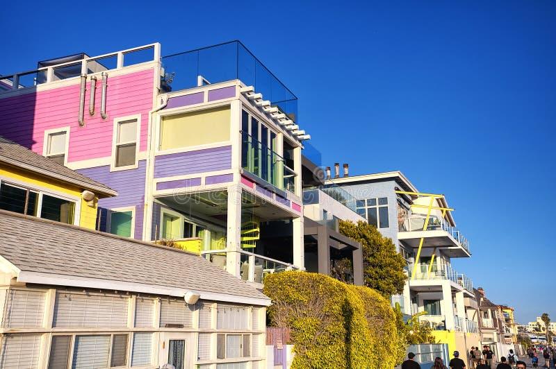 Santa Monica Beachfront homes california. People walking by santa monica beach front homes in California stock photos